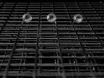 3 индивидуальных диаманта поверх решетки стоковая фотография
