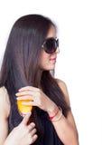 Индийская девушка расчесывая ее волос. Стоковая Фотография