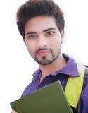 Индийский студент колледжа над белой предпосылкой. Стоковые Изображения RF