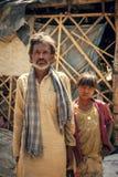 Индийский человек сельчанина с сынком Стоковые Изображения RF