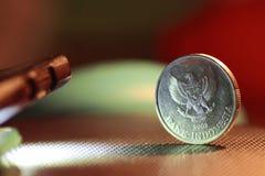 Индонезийская монетка с логотипом орла Ява стоковое фото rf