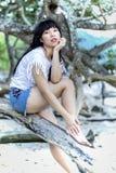 Индонезийское усаживание девушки Стоковое Изображение