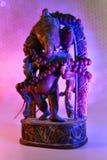 Индусский бог - лорд Ganesha с розарием rudraksha в красочном lig стоковое фото