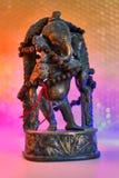 Индусский бог - лорд Ganesha с розарием rudraksha в красочном lig стоковая фотография