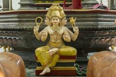 Индусское божество с 3 головами стоковое изображение rf