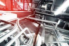 Индустриальная зона, стальные трубопроводы и насосы Стоковая Фотография