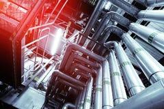 Индустриальная зона, стальные трубопроводы и насосы Стоковое Фото
