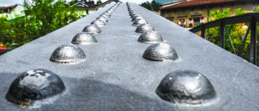 Инженерство детали крупного плана моста заклепки Стоковое фото RF