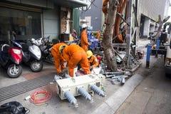 Инженеры и работники с электриками электричества Стоковое Фото