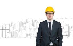 Инженер в желтом шлеме Стоковая Фотография