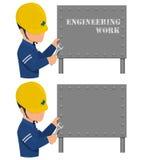 Инженер исправляет знак металла Стоковые Изображения RF