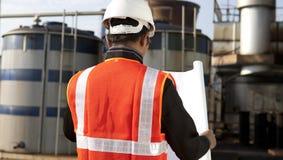 Инженер на месте положения с светокопией Стоковая Фотография RF