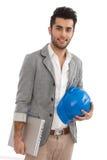 Инженер с компьтер-книжкой и защитным шлемом стоковые изображения rf
