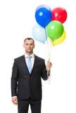длинной с Полу портрет бизнесмена с воздушными шарами Стоковая Фотография RF