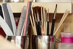 Инструменты в студии ногтя Стоковая Фотография RF