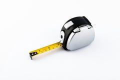 Инструменты инструменты ленты измерения предпосылки белые Стоковые Изображения