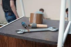 Инструменты и 3 работника Стоковое Изображение