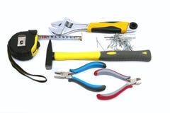 Инструменты конструкции - молоток, ноготь, плоскогубцы, рулетка стоковое изображение