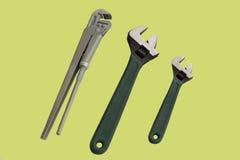 Инструменты на желтой предпосылке Стоковая Фотография