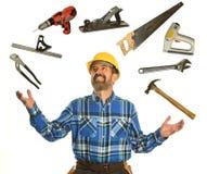 Инструменты работника жонглируя стоковые фотографии rf