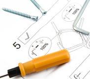 Инструменты с листом инструкции мебели собирая Стоковое Фото