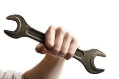 Инструмент гаечного ключа владением руки в руке Стоковые Фото