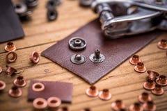 Инструмент и пряжки пунша Стоковая Фотография