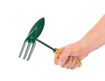 Инструмент сапки сада в руке Стоковые Изображения