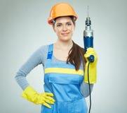Инструмент сверла удерживания построителя женщины Стоковые Изображения RF
