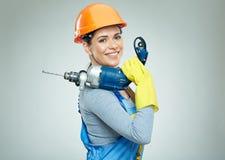 Инструмент сверла удерживания построителя женщины Стоковое фото RF