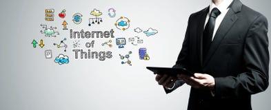 Интернет вещей при человек держа планшет стоковые фотографии rf