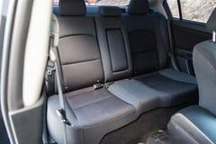 Интерьер автомобиля с целью задних сидений s со светлым - серая отделка стоковое изображение rf