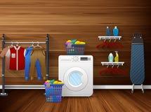 Интерьер прачечной с стиральной машиной, утюжа доской и одеждами засыхания Стоковое Изображение