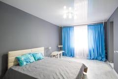 Интерьер спальни серый тон Стоковое Изображение