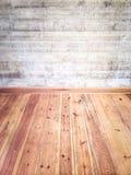 Интерьер с деревянными полом и бетонной стеной Стоковая Фотография