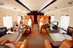 Интерьер частного самолета стоковое изображение