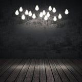 Интерьер черноты с электрическими лампочками стоковая фотография