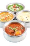 Индийская еда в шарах металла на белой предпосылке Стоковое Фото