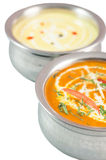 Индийская еда в шарах металла на белой предпосылке Стоковое фото RF