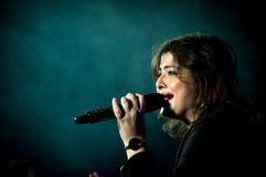 Индийская певица выполняя на этапе стоковое изображение