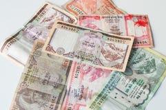 Индийские деньги - банкноты национального банка Непала Rastra - примечания рупий Непала Стоковое фото RF