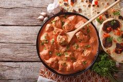 Индийский цыпленок masala tikka на таблице горизонтальное взгляд сверху Стоковое Изображение