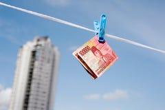 Индонезийская смертная казнь через повешение рупии банкнот на веревочке стоковое фото rf