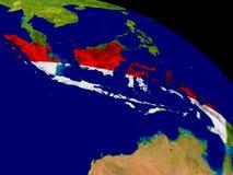 Индонезия с флагом на земле Стоковое Фото