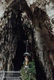 Индусская статуя ` s божественная перед пещерой Batu выдалбливает около Куалаа-Лумпур, Малайзии Стоковое фото RF