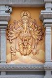 Индусский бог Ganesh с много оружий Стоковая Фотография RF