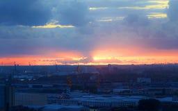 Индустриальная зона на заходе солнца Стоковое Фото