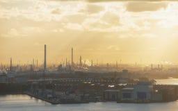 Индустриальная зона на заходе солнца Стоковые Изображения