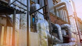 Индустриальная зона, стена промышленного здания с трубами Стоковые Фото