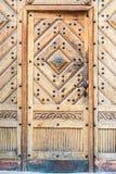 Исконное оформление металла двери Fretwork Брайна деревянное стоковое изображение